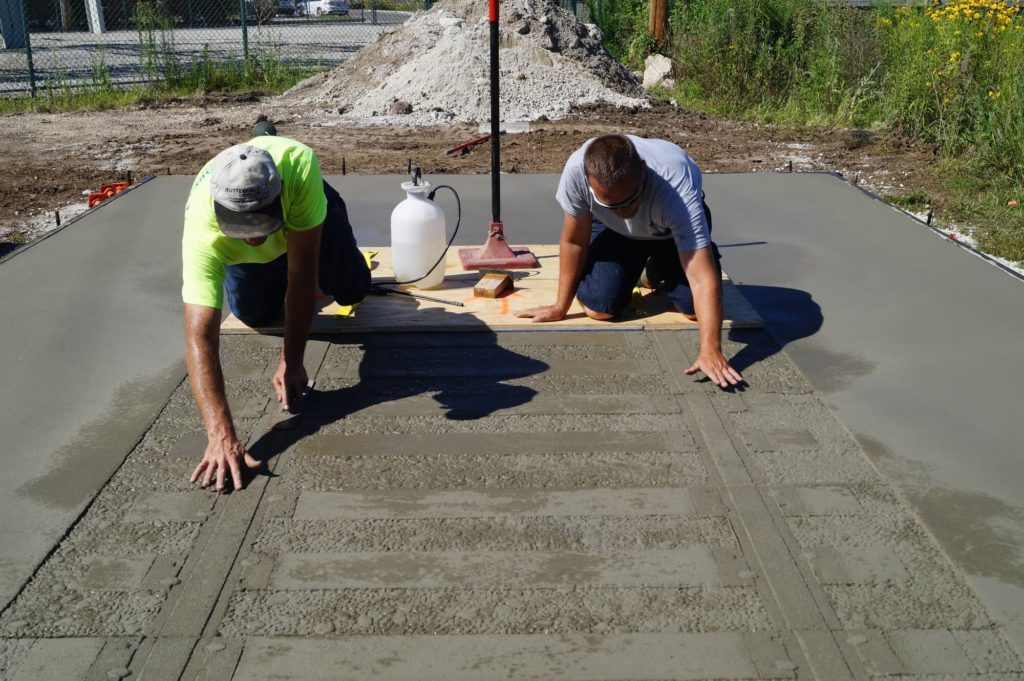 Brandon-Tampa Custom Concrete Pros-We offer custom concrete solutions, Polished concrete, Stained concrete, Epoxy Floor, Sealed concrete, Stamped concrete, Concrete overlay, Concrete countertops, Concrete summer kitchens, Driveway repairs, Concrete pool water falls, and more