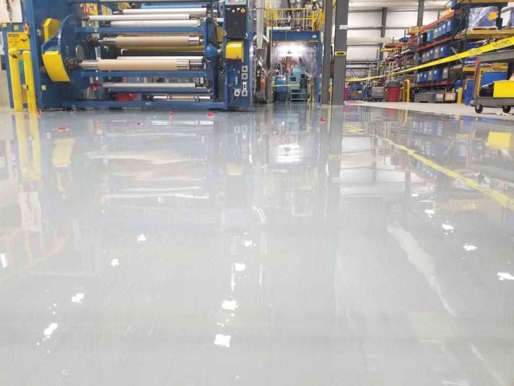 Epoxy Floor Systems-Tampa Custom Concrete Pros-We offer custom concrete solutions, Polished concrete, Stained concrete, Epoxy Floor, Sealed concrete, Stamped concrete, Concrete overlay, Concrete countertops, Concrete summer kitchens, Driveway repairs, Concrete pool water falls, and more